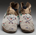 American Indian Art:Beadwork and Quillwork, A PAIR OF SOUTHERN CHEYENNE BEADED HIDE MOCCASINS. c. 1900...(Total: 2 )