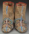 American Indian Art:Beadwork and Quillwork, A PAIR OF SEMINOLE BEADED HIDE MOCCASINS. c. 1870... (Total: 2Items)