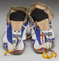 American Indian Art:Beadwork and Quillwork, A PAIR OF SIOUX BEADED BUFFALO HIDE MOCCASINS. c. 1885... (Total: 2Items)