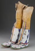American Indian Art:Beadwork and Quillwork, A PAIR OF CHEYENNE BEADED HIDE BOOT MOCCASINS. c. 1890... (Total: 2Items)