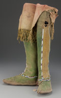 American Indian Art:Beadwork and Quillwork, A PAIR OF COMANCHE BEADED HIDE BOOT MOCCASINS. c. 1880... (Total: 2Items)