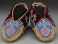 American Indian Art:Beadwork and Quillwork, A PAIR OF DELAWARE BEADED HIDE MOCCASINS. c. 1890... (Total: 2Items)