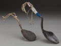 American Indian Art:Pipes, Tools, and Weapons, TWO PLAINS CARVED BUFFALO HORN SPOONS. c. 1870 and 1890... (Total:2 Items)