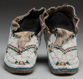 American Indian Art:Beadwork and Quillwork, A PAIR OF ARAPAHO BEADED HIDE MOCCASINS. c. 1900... (Total: 2 )