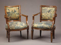 Furniture : Continental, A Pair of Italian Neoclassical Walnut Armchairs. . Late 18thCentury. Walnut. 35 inches high. ... (Total: 2 Items)