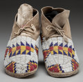 American Indian Art:Beadwork and Quillwork, A PAIR OF SIOUX BEADED HIDE MOCCASINS. c. 1900... (Total: 2 )