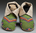 American Indian Art:Beadwork and Quillwork, A PAIR OF SIOUX BEADED HIDE MOCCASINS. c. 1910... (Total: 2 )