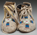 American Indian Art:Beadwork and Quillwork, A PAIR OF ARAPAHO BEADED HIDE MOCCASINS... (Total: 2 )