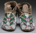 American Indian Art:Beadwork and Quillwork, A PAIR OF SIOUX BEADED HIDE MOCCASINS. c. 1890 ... (Total: 2 )