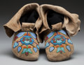 American Indian Art:Beadwork and Quillwork, A PAIR OF NEZ PERCE BEADED HIDE MOCCASINS. c. 1910... (Total: 2 )
