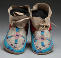 American Indian Art:Beadwork and Quillwork, A PAIR OF SIOUX BEADED HIDE MOCCASINS... (Total: 2 )