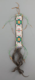 American Indian Art:Beadwork and Quillwork, A SIOUX BEADED HIDE HAIR ORNAMENT. c. 1890. ...