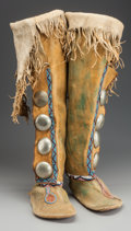 American Indian Art:Beadwork and Quillwork, A PAIR OF KIOWA BEADED HIDE BOOT MOCCASINS. c. 1880... (Total: 2Items)
