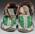 American Indian Art:Beadwork and Quillwork, A PAIR OF SIOUX BEADED HIDE MOCCASINS. c. 1890... (Total: 2 )
