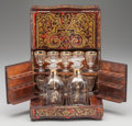 Decorative Arts, French, A NAPOLEON III BOULLE AND GILT GLASS CAVE A LIQUEUR, circa 1865.9-1/8 x 10 x 7-1/4 inches (23.2 x 25.4 x 18.4 cm). ... (Total: 14Items)