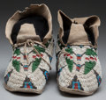 American Indian Art:Beadwork and Quillwork, A PAIR OF CHEYENNE BEADED HIDE MOCCASINS. c. 1890... (Total: 2 )