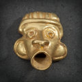Pre-Columbian:Metal/Gold, A CALIMA GOLD HUMAN FACE WITH OPEN MOUTH...
