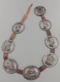 American Indian Art:Jewelry and Silverwork, A NAVAJO SILVER CONCHO BELT. c. 1920...