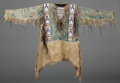 American Indian Art:War Shirts/Garments, A SIOUX BEADED HIDE WAR SHIRT. c. 1900...