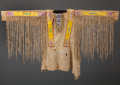 American Indian Art:War Shirts/Garments, A FT. BERTHOLD QUILLED AND BEADED HIDE WAR SHIRT. c. 1890 ...