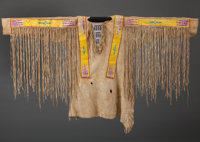 A FT. BERTHOLD QUILLED AND BEADED HIDE WAR SHIRT c. 1890