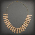 Pre-Columbian:Metal/Gold, MUSICA TWENTY-FOUR EMBOSSED GOLD PLAQUES STRUNG ON FINE GOLDCHAIN...