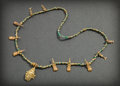 Pre-Columbian:Metal/Gold, A Calima Carchi Necklace with Gold Mosquito Larvae and a La TolitaPendant...