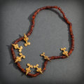 Pre-Columbian:Metal/Gold, A CALIMA NECKLACE OF AMBER BEADS AND GOLD BIRD PENDANTS...