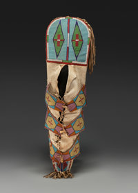 A RARE CROW BEADED HIDE CRADLEBOARD c. 1890