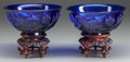 Asian:Chinese, A PAIR OF CHINESE BLUE PEKING GLASS BOWLS WITH CARVED MAHOGANYSTANDS, 20th century. 2-3/4 inches high x 6-3/8 inches diamet...(Total: 4 Items)