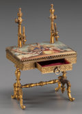Decorative Arts, French, A MINIATURE FRENCH ENAMEL AND GILT BRONZE MODEL OF A DESK, circa1900. 3-5/8 x 2-1/2 x 1-3/4 inches (9.2 x 6.4 x 4.4 cm). ...