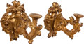 Decorative Arts, Continental, A PAIR OF ITALIAN BAROQUE CARVED GILTWOOD SINGLE-LIGHT WALLSCONCES, circa 1750. 25 x 17-1/2 x 25 inches (63.5 x 44.5 x 63.5...(Total: 2 Items)