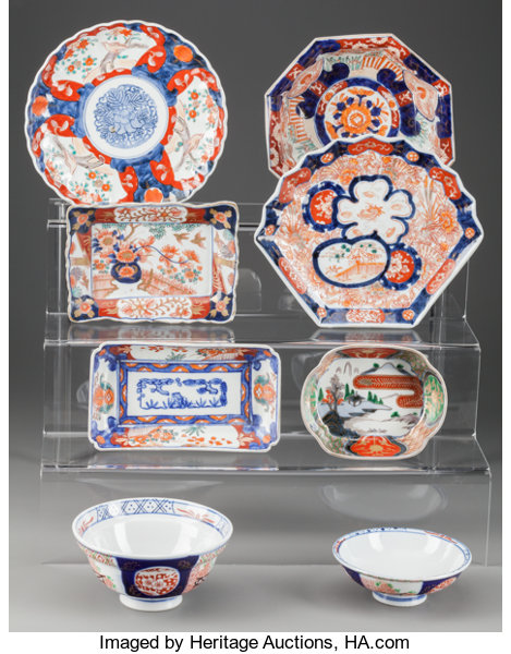 A GROUP OF EIGHT JAPANESE IMARI SERVING DISHES AND BOWLS