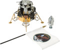 Explorers:Space Exploration, Apollo 11 Franklin Mint LM Model, Corgi Ornament, and MissionInsignia Flag, Originally from the Personal Collection of Buzz A...(Total: 3 Items)