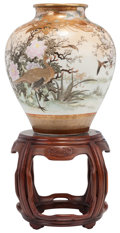 Asian:Japanese, A LARGE JAPANESE SATSUMA CERAMIC VASE ON A CARVED MAHOGANY ANDMARBLE STAND, 20th century. 32 inches high (81.3 cm) (includi...
