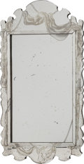 Decorative Arts, French, A FRENCH SILVERED GLASS MIRROR WITH TROMPE L'OEIL DRAPERY, circa1930. 47 inches high x 24-1/2 inches wide (119.4 x 62.2 cm)...