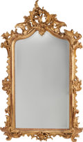 Furniture : French, A LOUIS XV-STYLE CARVED GILTWOOD MIRROR, circa 1865. 73-1/2 incheshigh x 45 inches wide (186.7 x 114.3 cm). ...