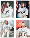 Autographs:Celebrities, Apollo Astronauts Signed White Spacesuit Color Photos (Four). ...(Total: 4 Items)