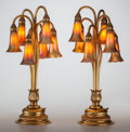 Art Glass:Tiffany , PAIR OF TIFFANY STUDIOS GILT BRONZE AND FAVRILE GLASS SIX-LIGHTLILY LAMPS, circa 1910. Marks to bases: TIFFANY ... (Total:14 Items)