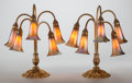 Art Glass:Tiffany , PAIR OF TIFFANY STUDIOS GILT BRONZE AND FAVRILE GLASS FIVE-LIGHTLILY LAMPS, circa 1925. Marks to bases: (miss s... (Total:12 Items)