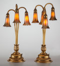 Art Glass:Tiffany , PAIR OF TIFFANY STUDIOS GILT BRONZE AND FAVRILE GLASS FOUR-LIGHTLILY LAMPS, circa 1910. Marks to bases: TIFFA... (Total:10 Items)