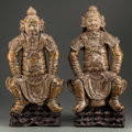 Asian:Chinese, A PAIR OF CHINESE GLAZED TERRACOTTA WARRIORS ON CARVED WOOD BASES,pre-Ming dynasty. 22 inches high (55.9 cm). ... (Total: 2 Items)