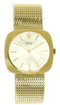 Timepieces:Wristwatch, Rolex, Men's Gold Integral Bracelet Wristwatch, Circa 1960. Case:32 mm, 14k yellow gold.. Dial: silvered with applied gol...