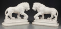 Decorative Arts, Continental, A PAIR OF CARRERA MARBLE LIONS, 20th century. 11 x 14 x 6 inches(27.9 x 35.6 x 15.2 cm). PROPERTY FROM THE ESTATE OF FRED...(Total: 2 Items)