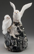 Decorative Arts, Continental, A PAIR OF CARVED HARDSTONE OWLS ON A TOURMALINE BASE AFTER PETERMULLER, 20th century. 17-1/4 inches high (43.8 cm). ...