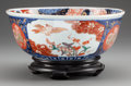Asian:Japanese, A JAPANESE IMARI PORCELAIN BOWL ON A CARVED MAHOGANY STAND, circa1900. 4-1/2 inches high x 11 inches diameter (11.4 x 27.9 ...(Total: 2 Items)