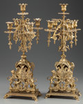Decorative Arts, Continental:Lamps & Lighting, A PAIR OF GOTHIC REVIVAL BRASS FIVE-LIGHT CANDELABRA, 20th century.21-3/4 inches high (55.2 cm). PROPERTY FROM THE ESTATE... (Total: 2Items)