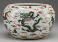 Asian:Chinese, A CHINESE POLYCHROME EARTHENWARE JARDINIÈRE. 6-1/2 inches high x 10inches diameter (16.5 x 25.4 cm). ...