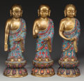 Asian:Chinese, A GROUP OF THREE CHINESE CLOISONNÉ AND GILT METAL BUDDHAS, 20thcentury. 18 inches high (45.7 cm) (each). ... (Total: 3 Items)
