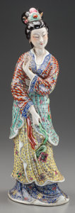 Asian:Chinese, A CHINESE POLYCHROME PORCELAIN FIGURE OF A STANDING GUANYIN. Marks:(two four-character marks). 16-3/4 inches high (42.5 cm)...